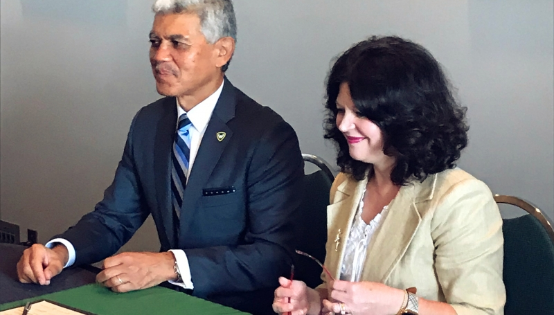 Wayne State University President Dr. M. Roy Wilson and St. Clair College President Patti France